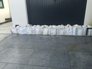 Mini Flood Wall Bags protecting a roll-up door